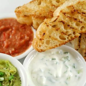 2415800 - delicious and colorful trio of dips with grilled turkish bread.